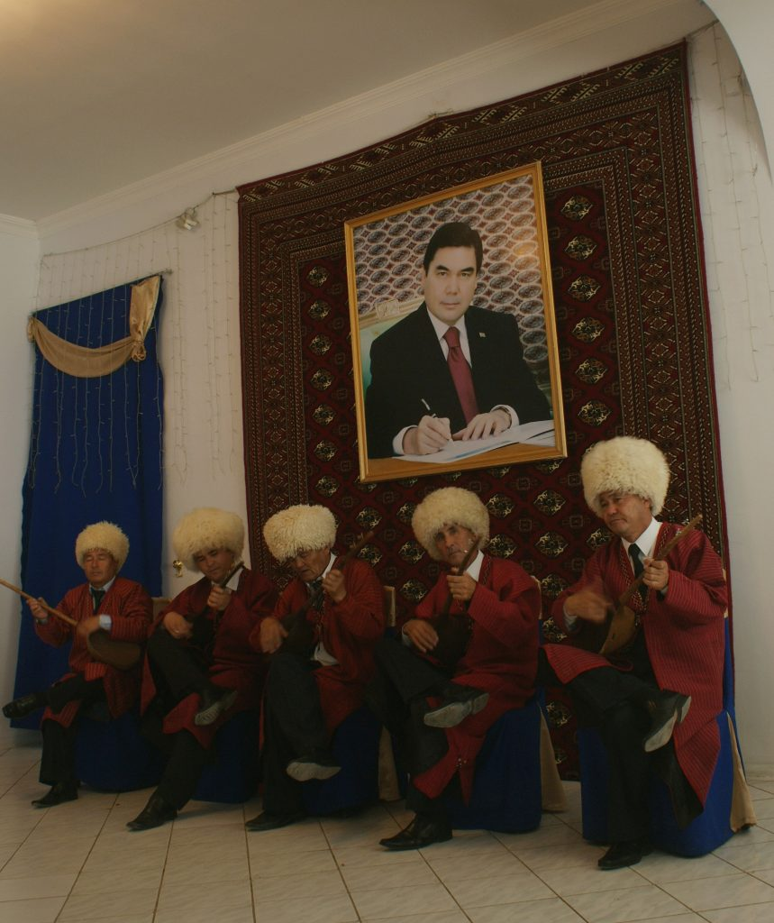 By Abel Polese, Musicians, Turkmenistan, Mary oblast' 2011 - One of the many music shows shown to foreign researchers during an international event. I found it emblematic and intriguing that musicians were placed exactly under a large photo of Berdimuhammedov as if he was overseeing them. The image highlights once more the cult of personality developed in the country since 1991.