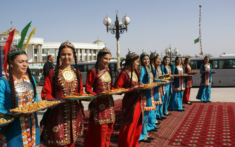 """Abel Polese, Welcoming – Turkmenistan – Mary 2011  Foreign guests arrived to the national theater for an international event. They were offered an idyllic picture of the country, full of young women and a taste of national food. This also informed some of my work on nationalism echoing what Vonnegut said """"we are what we pretend to be"""". We offer an image of the country in which we would like to believe ourselves, hoping that our guests will buy it and then convince us that we are really like that."""