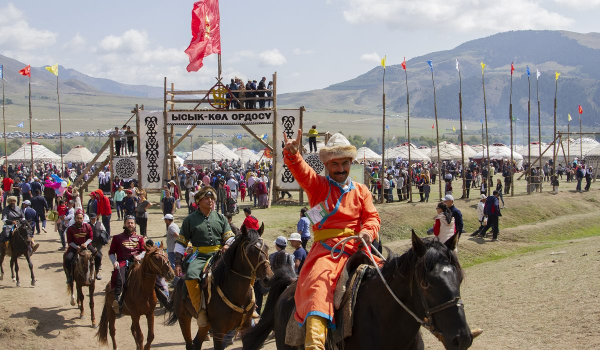 """Assel Choibekova, Kyrzgystan, 2018  The World Nomad Games took place in Kyrgyzstan on the """"shoe side"""" of lake Issyk Kul. Surrounded by the jagged peaks of the Tian Shan mountain range and the vast meadows of a sweeping mountain Kyrchyn Gorge, Issyk Kul is the second largest alpine lake in the world"""