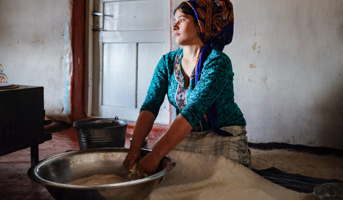 Cara Kerven, In the Gara Gum desert of Turkmenistan, a newly married women kneads bread for her husband's family. After letting the dough rise, she will take it outside to the clay oven (tamdyr) and secure the loaves to the hot walls inside. The tedious process of cleaning the baked loaves is shared between her and her husband's brother's wives (elti). She wears the appropriate silk scarf (gýnaç) of a married women and, when in the presence of older men, secures a portion of the scarf in her mouth (ýaşmak).