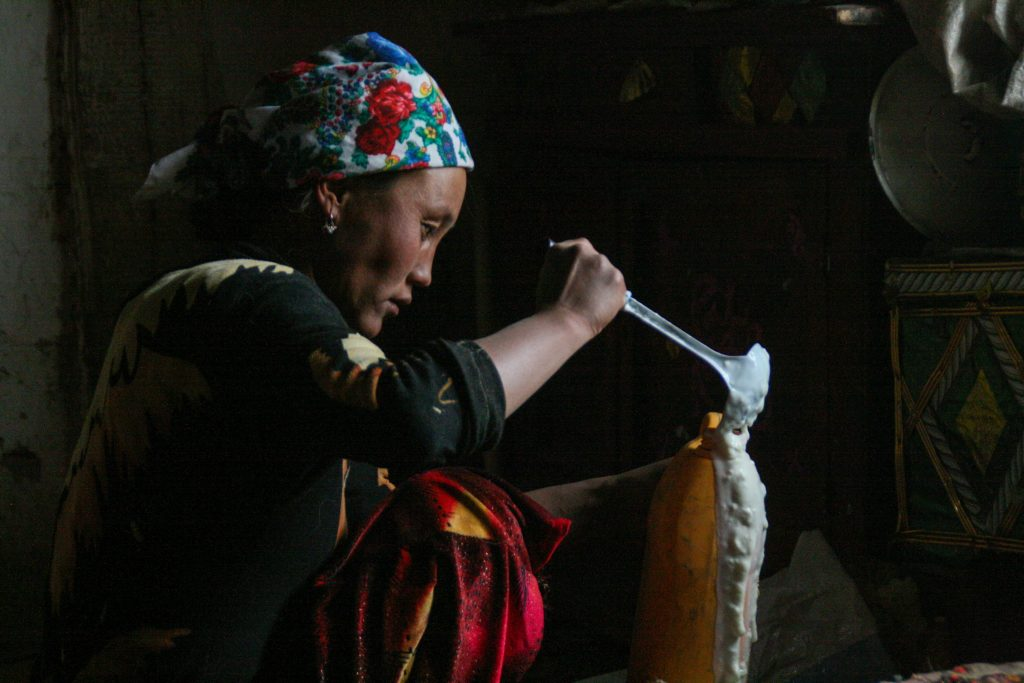 By Cara Kerven - In Murghab town, the largest settlement in the eponymously named district in Gorno-Badakhshan Autonomous Region, Tajikistan. Manyfamilies lease their livestock to hired shepherds. Here, the wife of a shepherd pours yogurt (ayran) made from yak's milk to take with us back into Murghab town.