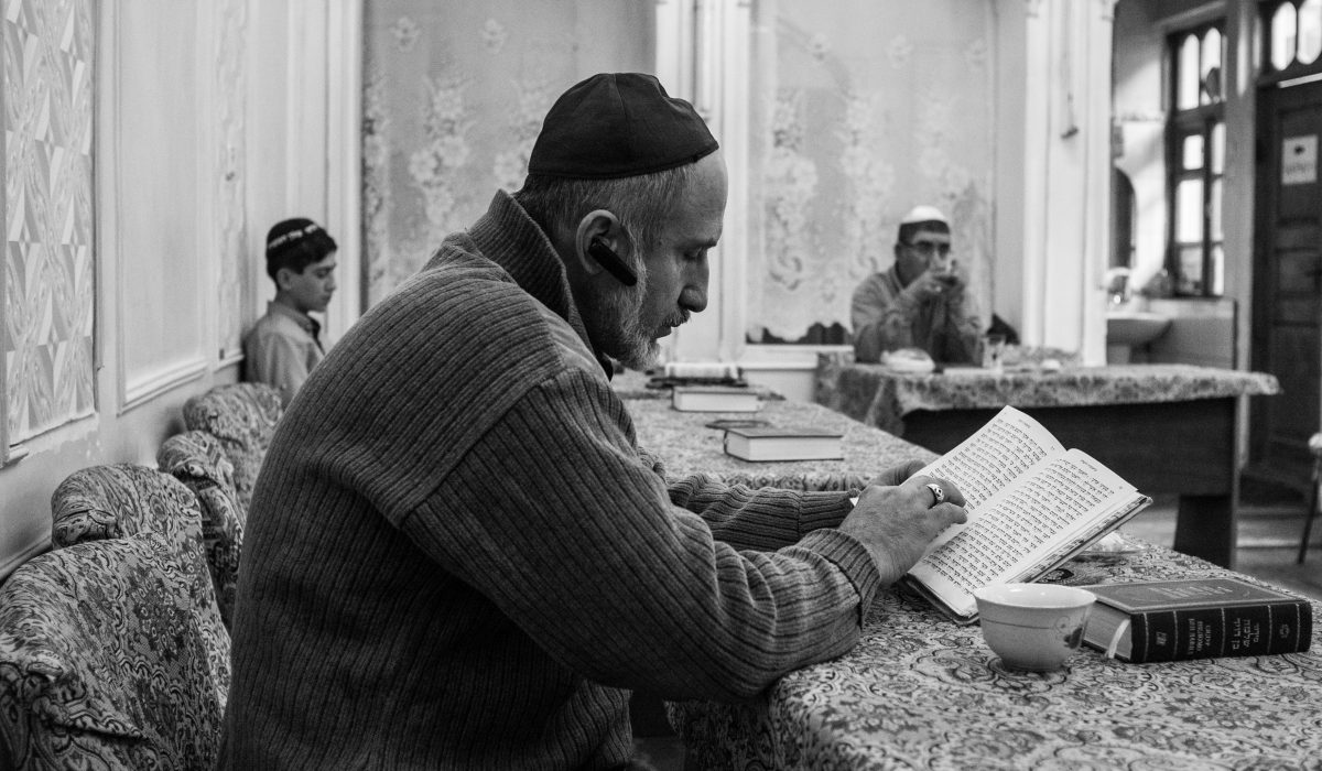Everett Price, Uzbekistan, 2018, Two senior policy advisors at the U.S. Commission on Security and Cooperation in Europe (U.S. Helsinki Commission) traveled to Bukhara, Uzbekistan as an official delegation to investigate the state of religious freedom in the country. This picture was taken by one of the advisors during a meeting with the Bukhari Jewish community in a local synagogue.