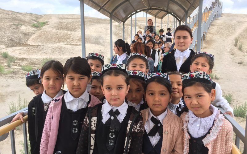Farit Gabdulhakov, Uzbekistan, 2019, School children from the city of Namangan on an excursion to the ancient city of Akhsikent. Destroyed by an earthquake in 1622, Akhsikent was a city with well-developed metallurgy. Swords produced there were widely sold all over the region, including in the famous markets in Damascus. After the earthquake, Namangan was founded by a surviving resident of Akhsikent.