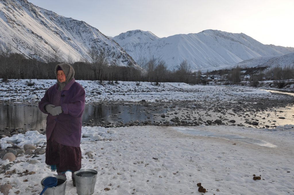 By Kateřina Zäch-Kozlová, Kyrgyz Woman on the Riverside of the Kökömeren, 2015 - The aim of my master's thesis (2017) was to systematically examine the everyday habitat of the water culture and changing infrastructure in the Kyrgyz village. My role as an ethnologist was to decipher social Kyzyl-Oi's organisation of water and complex networks of human relation using a water lens – whereby empirical research of water places of everyday life and water history, were of special importance. Kyzyl-Oi, Kyrgyzstan.