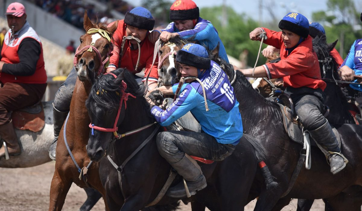 Moira O'Shea, Kyrgyzstan, 2018, Kelechek, the name of the team in blue, means 'the future' in Kyrgyz. Winning the Mayor's Cup during this game certainly meant big things for the team as they were able to compete in the Victory Day celebrations and have a chance to move from the semi-professional to professional league. While Kok-boru is a game with an ancient history, it is simultaneously being popularized and formalized in Kyrgyzstan with the creation of two leagues, and much attention being payed to international standards for the game. Bishkek, Kyrgyzstan, 2019.